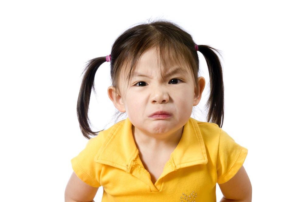 A young asian american girl making a face. Education, Future